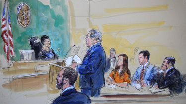 This courtroom sketch depicts Maria Butina, in orange suit, a 29-year-old gun-rights activist suspected of being a covert Russian agent, listening to her lawyer Robert Driscoll, standing, as he speaks to Judge Deborah Robinson during a hearing in federal court in Washington on Wednesday.