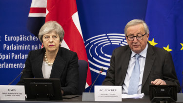 Theresa May listens as Jean-Claude Juncker, president of the European Commission, speaks after their meeting in Strasbourg, France.