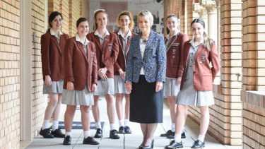 Principal Gaynor Robson-Garth with year 12 students at Camberwell's Siena College.