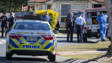 Police shot the man after he ran at them with a samurai sword.