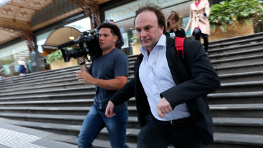 Reinier Jessurun (right) runs from court after his sentencing hearing on Thursday.