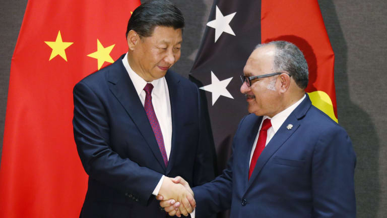 Papua New Guinea's Prime Minister Peter O'Neill shakes hands with Xi Jinping on Friday.