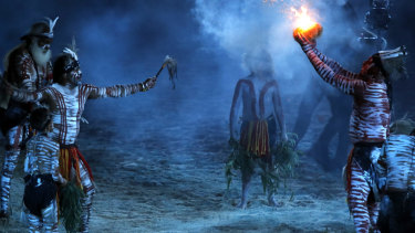 Indigenous dancers perform a smoking ceremony.