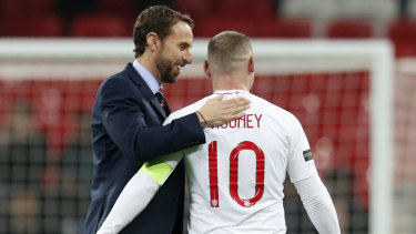 England manager Gareth Southgate shares a moment with Rooney after the game.