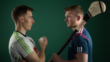 Kilkenny's Cillian Buckley faces off against Galway's Joe Canning.