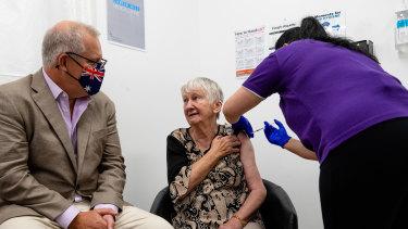 A nurse gives Jane Malysiak Australia's first COVID-19 vaccination on Sunday.