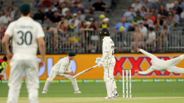 Reaction time: Steve Smith dives to catch and remove Kane Williamson.