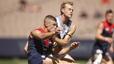 Port Adelaide recruit Jack Watts lays a tackle on former teammate Jake Melksham.