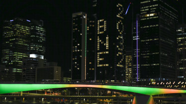 """A general view is seen as """"BNE 2032"""" is displayed on a building during the announcement of the host city for the 2032 Olympic Games"""