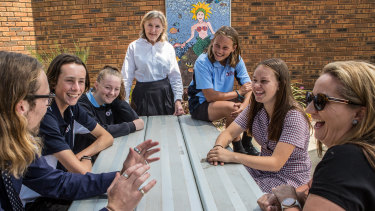 Barb Hadlow, acting principal of Lakes Entrance Secondary College (centre), with students and teachers.