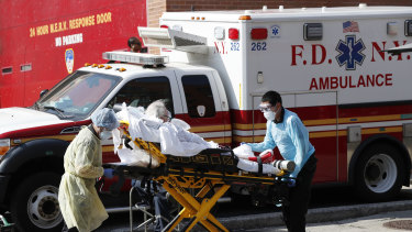 A patient is transferred to a waiting ambulance in New York.