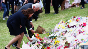 Premier Annastacia Palaszczuk and MP Joe Kelly lay flowers during the vigil for Hannah and her children in February.