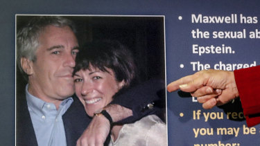 A US attorney points to a photo of millionaire Jeffrey Epstein and British socialite Ghislaine Maxwell during a news conference last year.