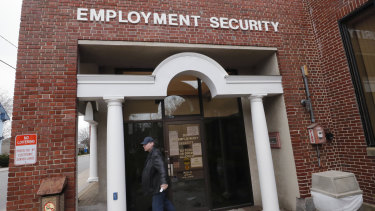 A man walks away from a locked door at the New Hampshire Employee Security centre, which handles unemployment claims, in Manchester, NH,