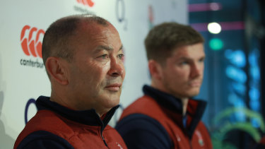 Jones is flanked by England captain Owen Farrell before the Six Nations opener.