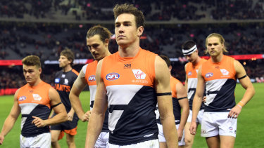 The Giants, led by Jeremy Cameron, trudge off after their loss to Essendon at Marvel Stadium on Thursday night.
