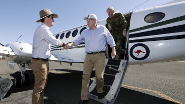 Prime Minister Scott Morrison is greeted at Quilpie airport by David Littleproud.