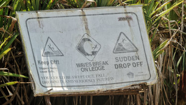 Warning signs at Devil's tears advising tourists about the dangers of the powerful waves.