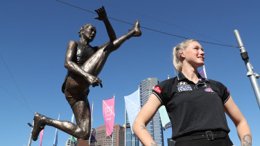 Tayla Harris poses with her statue in Federation Square.