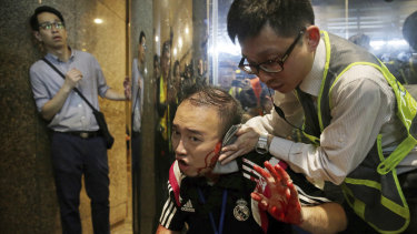 District councilor Andrew Chiu receives medical treatment in Hong Kong after the attack.