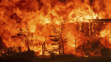 Flames consume a home as the River Fire tears though Lakeport, California on Tuesday.
