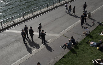 French police work to control people on the Seine river banks in Paris on March 31.