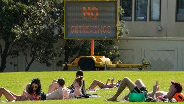 People gathering near St Kilda beach today.