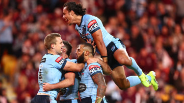 The Blues backline celebrate during game two at Suncorp Stadium.