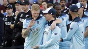 Ben Stokes and Eoin Morgan embrace after their thrilling victory at Lord's.