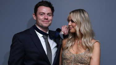 Lachie Neale of the Lions poses with his wife Jules after winning the Brownlow Medal.