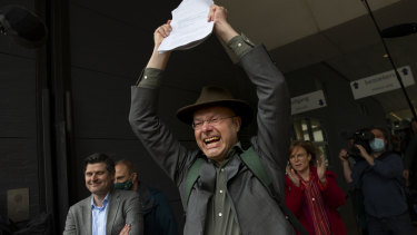 Environmentalists celebrate the outcome of the court case between the Dutch arm of the Friends of the Earth environmental organisation and Shell in The Hague, Netherlands.