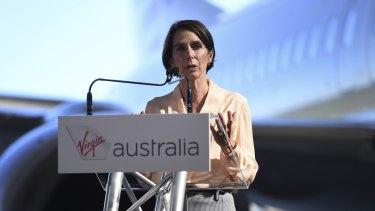 Virgin Australia CEO Jayne Hrdlicka speaks during a media event at the Virgin maintenance hangar at Brisbane Airport.