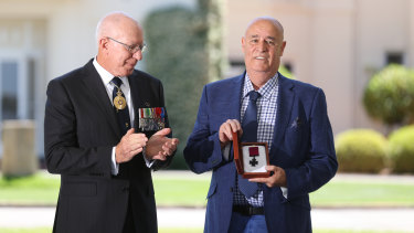 Governor-General David Hurley and Garry Ivory on behalf of the Sheean family during the Victoria Cross investiture ceremony on Tuesday.