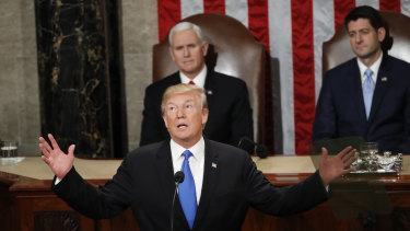 US President Donald Trump at the address last year. This time, a Democrat will be sitting over his shoulder.