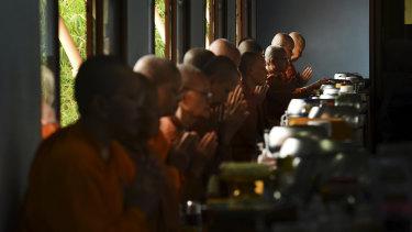 Female monks during a blessing before starting breakfast at the Songdhammakalyani Monastery.