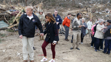Donald Trump and Melania in Alabama with tornado victims.