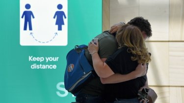 Nathan greets his partner moments after he arrives at the Sydney International Airport.