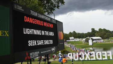 Storm warning: A sign warns of inclement weather after a delay was called during the third round of the Tour Championship golf tournament.