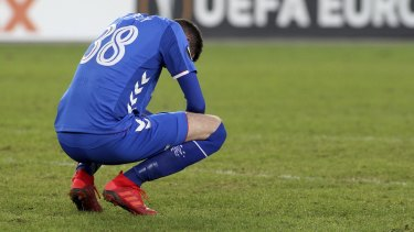 Rangers' Kyle Lafferty is dejected after losing to Rapid Vienna.