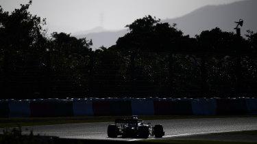 Lighting it up: Valterri Bottas pilots his Mercedes around the Suzuka track.
