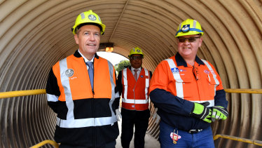 Bill Shorten - visiting a steel works in Whyalla, South Australia on Wednesday - is under pressure to reveal the costs of his climate change policy.