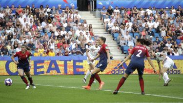 England's Jill Scott (right) watches as her shot at goal goes past Norway's defenders to score.