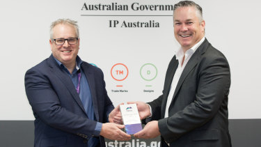 IP Australia general manager Robert Bollard receiving the award from Pegasystems's Luke McCormack.