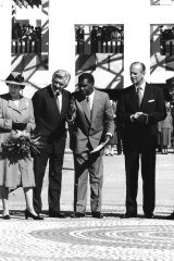 Kumantjayi Nelson Jagamara shows the Queen, Prince Philip, prime minister Bob Hawke and his wife Hazel at the Parliament House Forecourt Mosaic, May 1988.