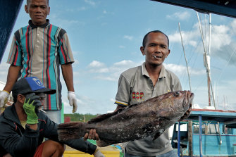 Dedi, a fisherman and resident of the Natuna Islands, with his catch.