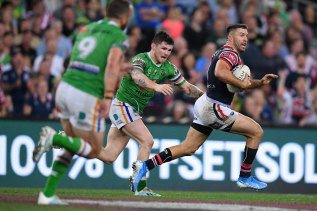 James Tedesco breaks away for the Roosters.