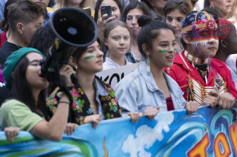 Swedish activist and student Greta Thunberg, centre, takes part in the Climate Strike, in Montreal on Friday.