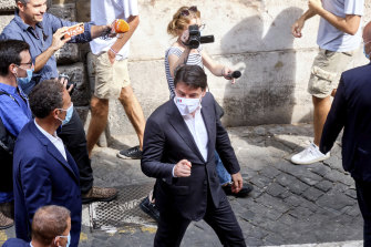 Italian Prime Minister Giuseppe Conte gestures as he arrives at a polling station, in Rome, on Sunday.