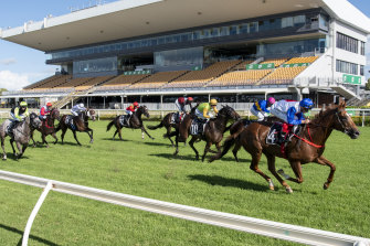 Jockey Michael Cahill rides Sofie's Gold Class to victory at Brisbane's Doomben Racecourse.