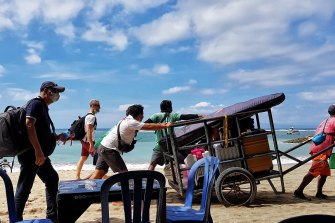Tourists at Sanur preparing to take a speed boat to the island of Nusa Lembongan this week.